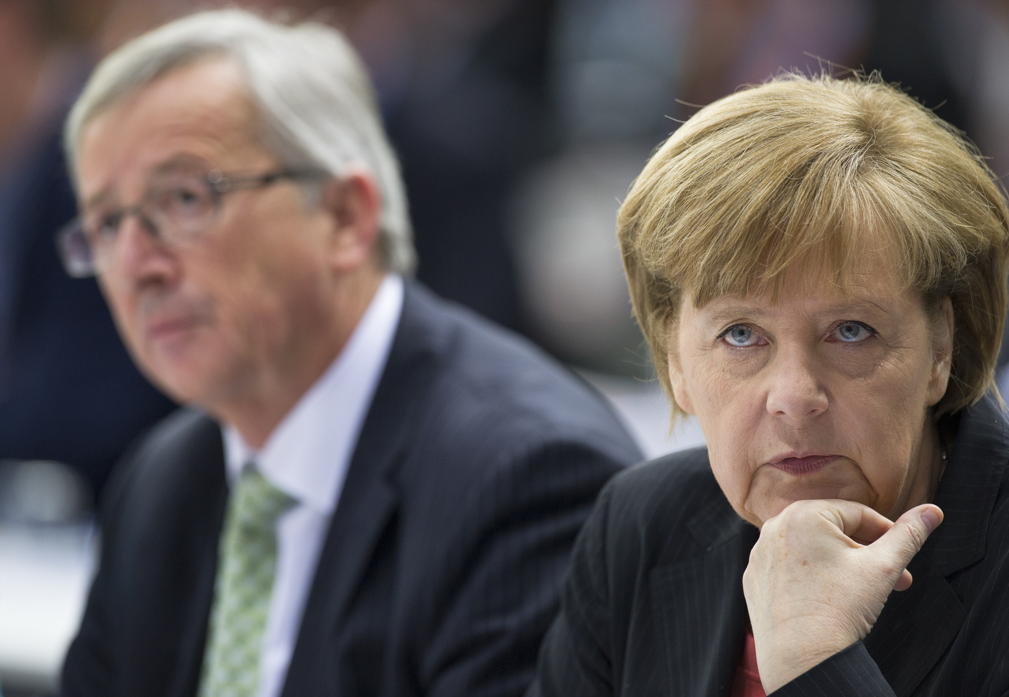German Chancellor Merkel, leader of the CDU and Juncker top candidate of European People's Party for European parliamentary elections, attend the CDU congress in Berlin